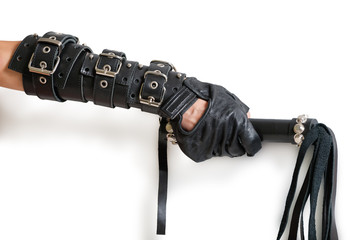 Hand in leather glove with lash and shadow