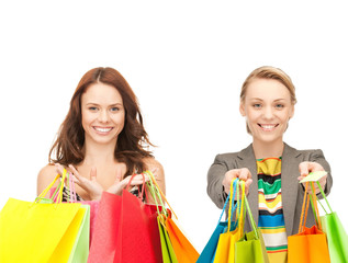 attractive girls holding color shopping bags