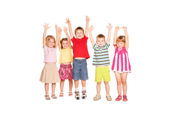 Group of children raising their hands up
