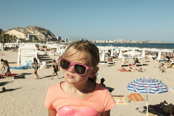 Girl with shades on a beach
