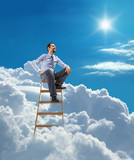 young businessman sits atop at the ladder high in the sky