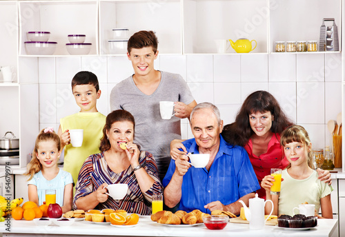 Big happy family have breakfast.