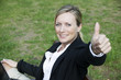 attractive young business woman showing a thumbs up