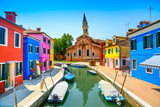 Venice landmark, Burano canal, houses, church and boats, Italy