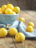 Yellow plums in blue bowl