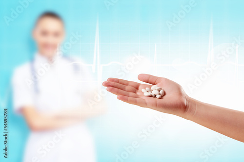 Human palm with pills