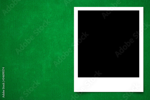 Photo frame on Green carpet background texture