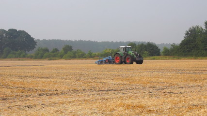 Tractors on farm field