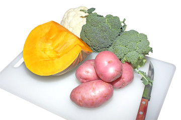 Fresh vegetable on chopping board  isolated