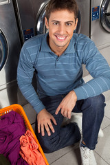 Man With Basket Of Clothes At Laundry