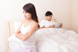 Couple with tablet pc iin bed