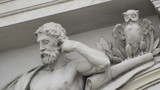 architectural detail of statue tracking shot