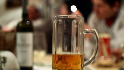 beer mug at party tracking shot