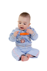 Child looks at the flying carrot