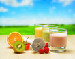 Fruit smoothie on wooden table on rural background