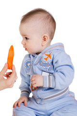 Child looks at the carrot
