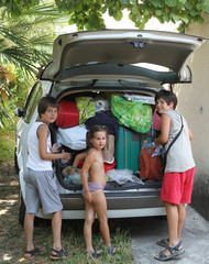 three brothers while downloading the car after the summer holida