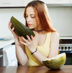 long-haired woman with ripe melon