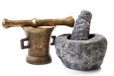 Granite and brass mortar with pestles on a white background