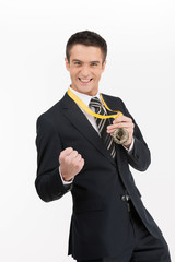 Businessmen with medal. Happy young businessman showing his gold
