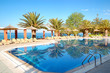Swimming pool by a beach at the modern luxury hotel, Thassos isl