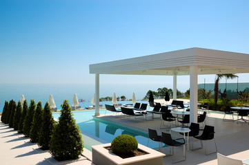 Swimming pool and outdoor restaurant at the modern luxury hotel,