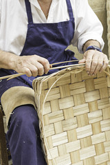 Craftsman making baskets