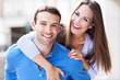 Leinwandbild Motiv Happy young couple