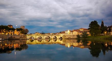 tiberius bridge twilight night view. Rimini Italy