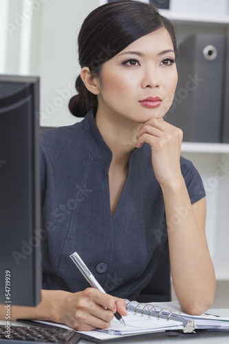 Asian Chinese Woman or Businesswoman in Office