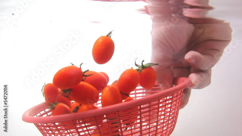closeup washing small potatoes with basket