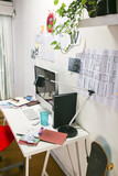 Modern creative workspace with computer and red chair. poster
