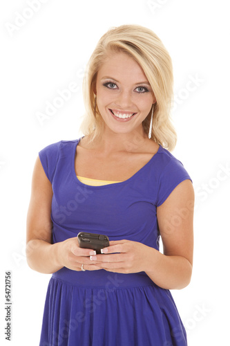woman blue top green pants phone look smile