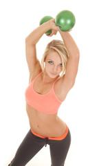 woman orange sports bra balls angle
