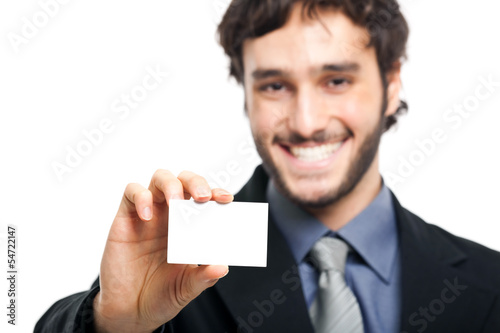Smiling businessman showing a blank card
