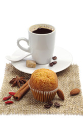 Small cupcake and cup of coffee