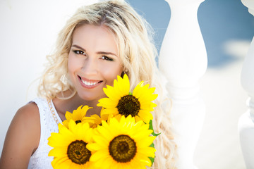portrait of attractive woman with sunflowers in her hand