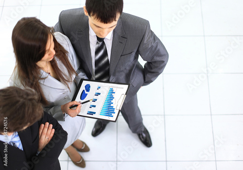Image of busiess group discussing business documents at meeting