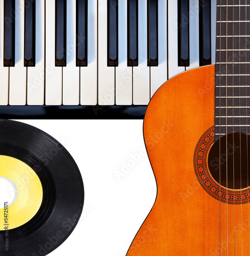 Guitar, piano and vinyl record.