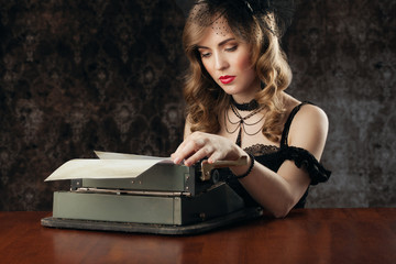woman and vintage typewriter