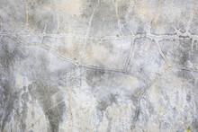 Mur blanc avec des fissures