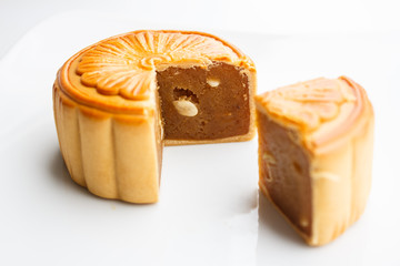durian pulp with lotus seed  filled moon cake on white backgroun