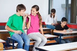 Teenage Boy And Girl Listening Music In Classroom