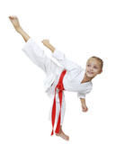 Girl in white kimono beats kicking isolated background