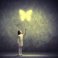 Little cute girl with butterfly balloon