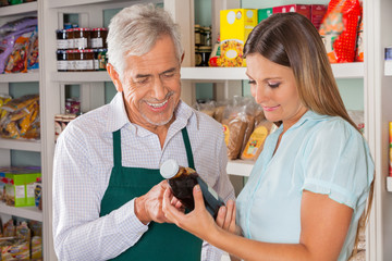 Male Owner Assisting Customer In Choosing Product