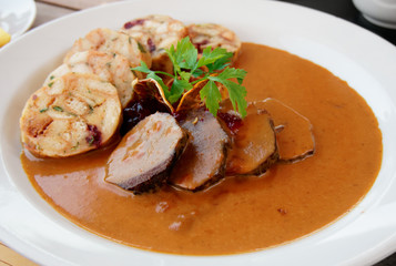 Veal fillet with rich sauce and dumplings