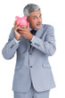 Curious businessman holding piggy bank