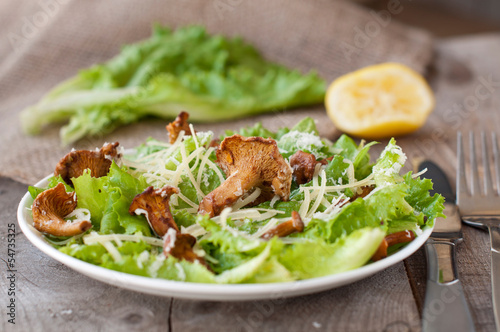 salad with mushrooms (chanterelles), parmesan, lettuce