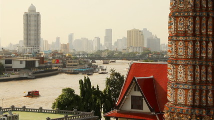 Ancient Thai mosaic and modern city. Chao Praya river, Bangkok.